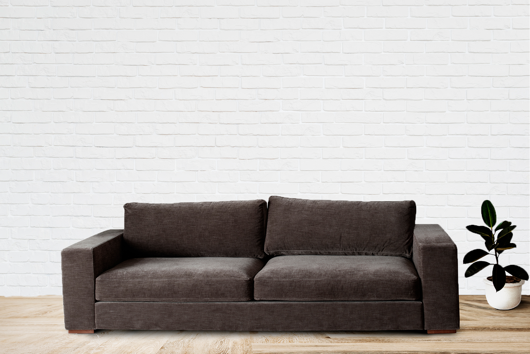 brow sofa white brick wall